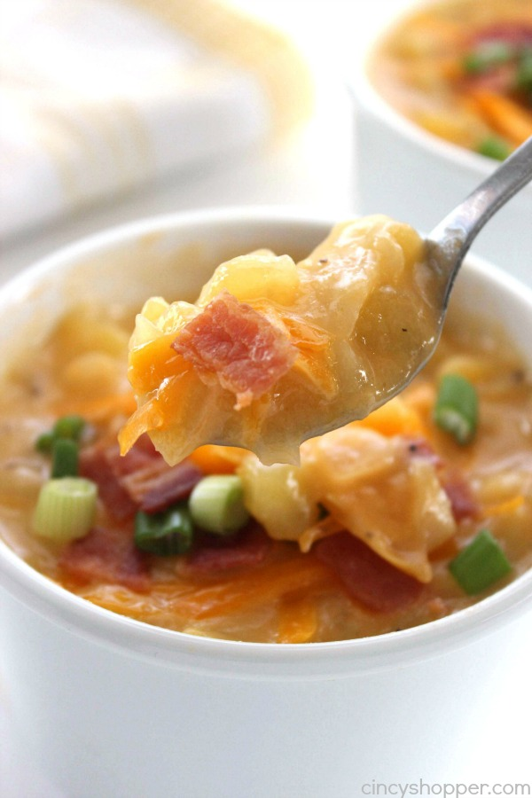 Slow Cooker Potato Soup - loaded with cheese and topped with bacon makes for a perfect winter meal. This cheesy soup is super simple and cooks all day right in your Crock-Pot.