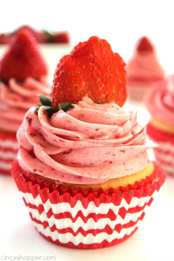 Strawberry Pie Cupcakes- Stuffed with strawberry pie filling and topped them off with the best strawberry butter cream frosting.