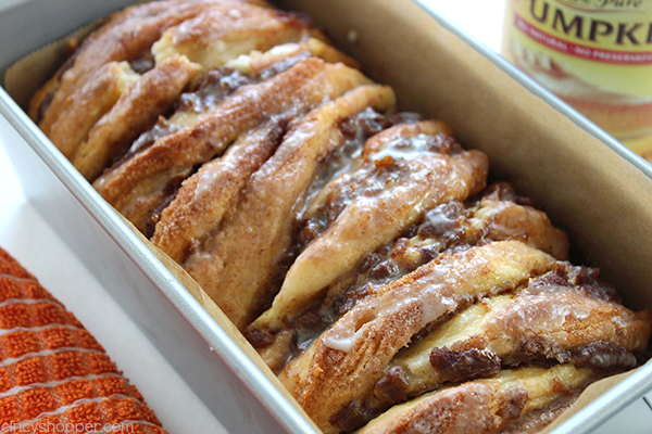 Pumpkin Pull Apart Loaf with Vanilla Glaze. Since the recipe starts with store bought biscuits, it is so easy to make.