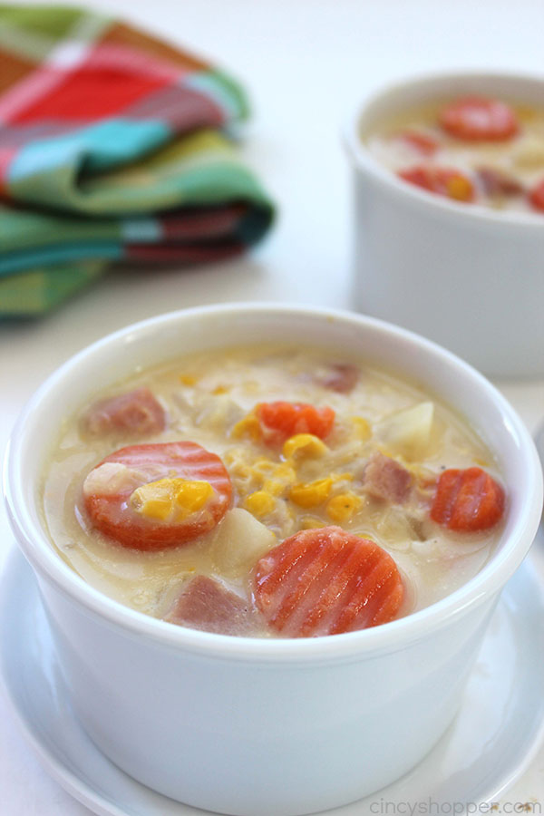 Slow Cooker Corn Chowder - Super simple. Since our recipe uses frozen potatoes, corn, carrots, and then precooked ham, it comes together quickly