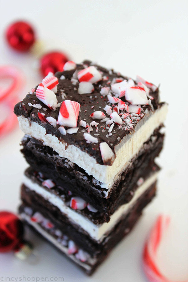 Peppermint Brownies - filled with a great peppermint buttercream frosting, a layer of chocolate frosting, and then topped with peppermint crunch sprinkles. Perfect for a Christmas dessert. Since they start with a boxed mix, they can be made quickly.