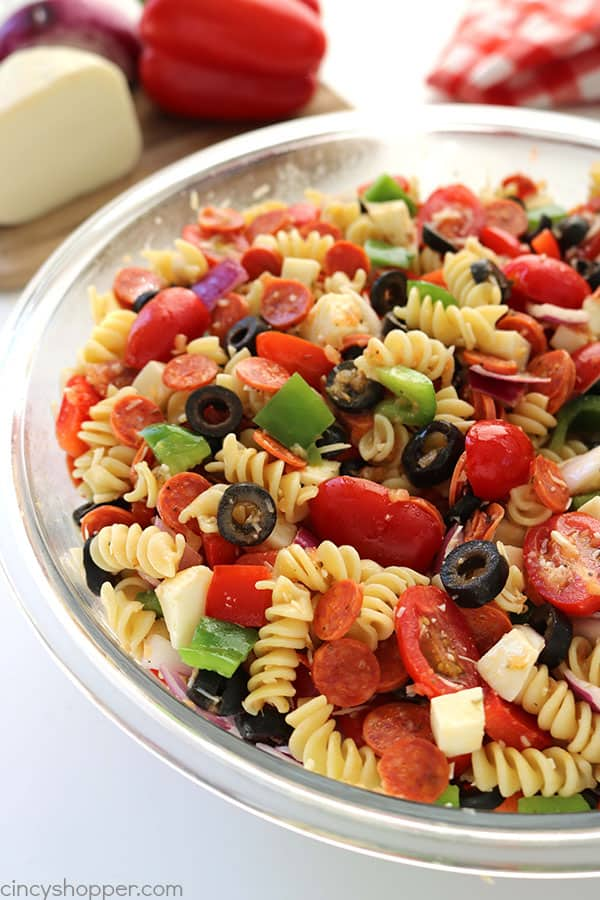 Pizza Pasta Salad has the tasty ingredients of a pizza right in a pasta salad. You will find it makes perfect side dish for your summer picnics, bbq's, and potlucks.
