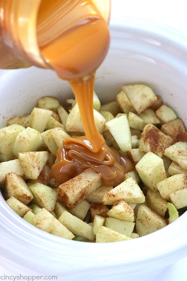 Grab your Crock-Pot and make this Slow Cooker Caramel Apple Dip and Cinnamon Chips. You will find it just like apple pie in the form of a dip. Perfect for feeding a crowd this fall.