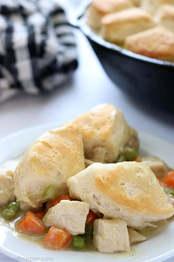 If you need a simple dinner idea, this Easy Skillet Chicken & Biscuits will be great for you to make. You will find it loaded with chicken, veggies and then topped with biscuits.#ChickenDinner
