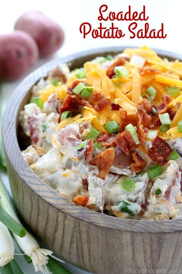 This Loaded Potato Salad will make for a great side dish at your summer picnics and BBQ's. We toss cubed potatoes with the fixings that you would normally find in a loaded baked potato. Lots of cheese, bacon, green onion, and of course sour cream. #SummerSalad