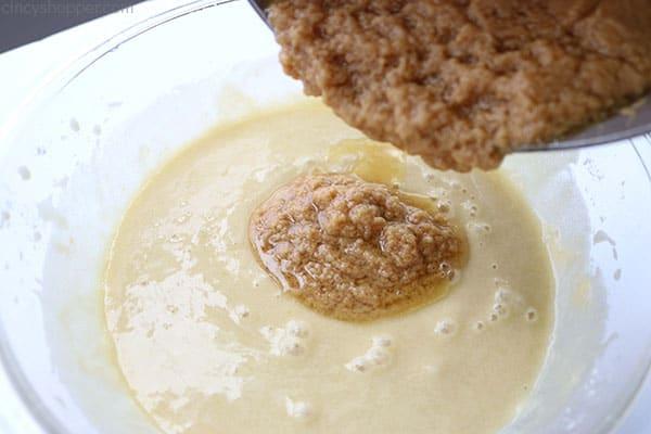 Blending peanut butter cake ingredients