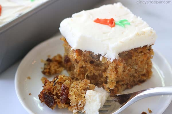 Fork on plate with carrot cake.
