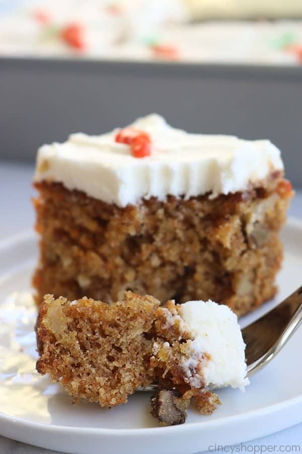 Slice of carrot cake with pineapple on plate.