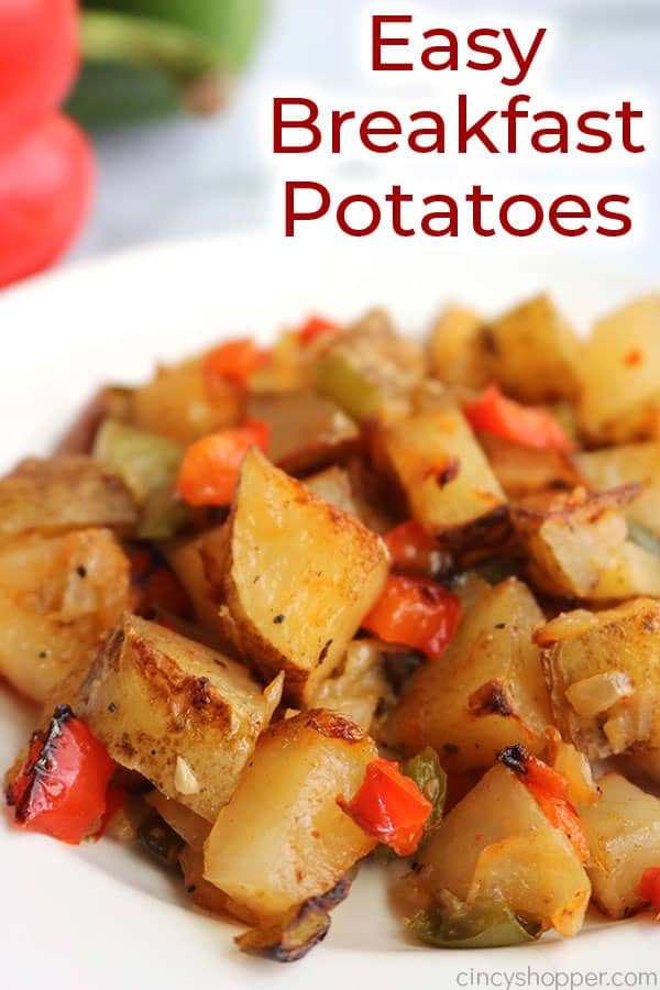 Breakfast potatoes with peppers and onions on a plate with text.