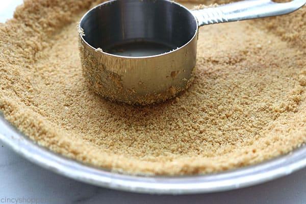 Making graham cracker crust.