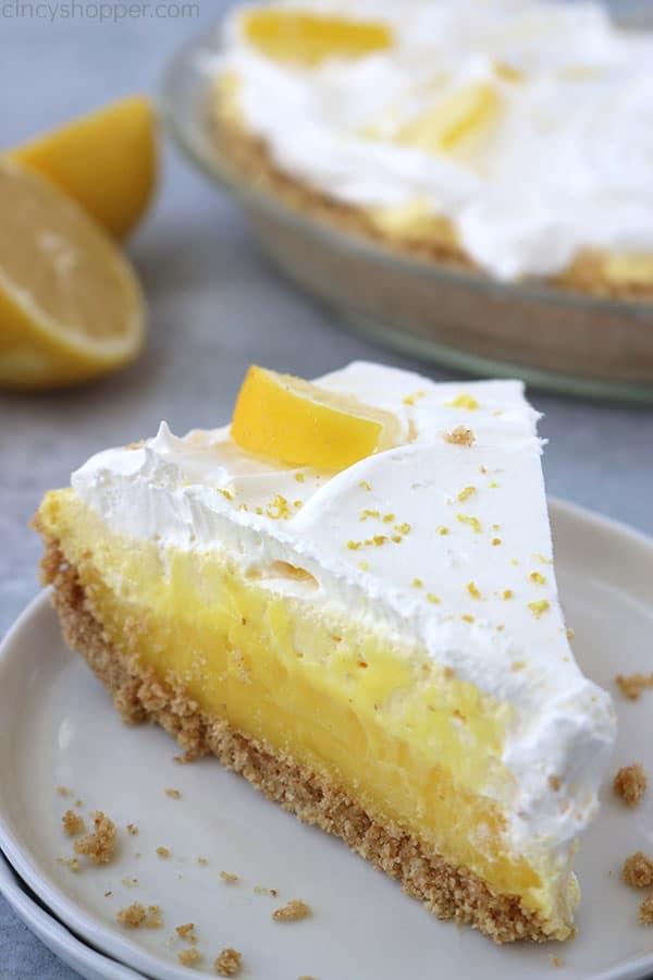 Slice of lemon pie on a white plate.