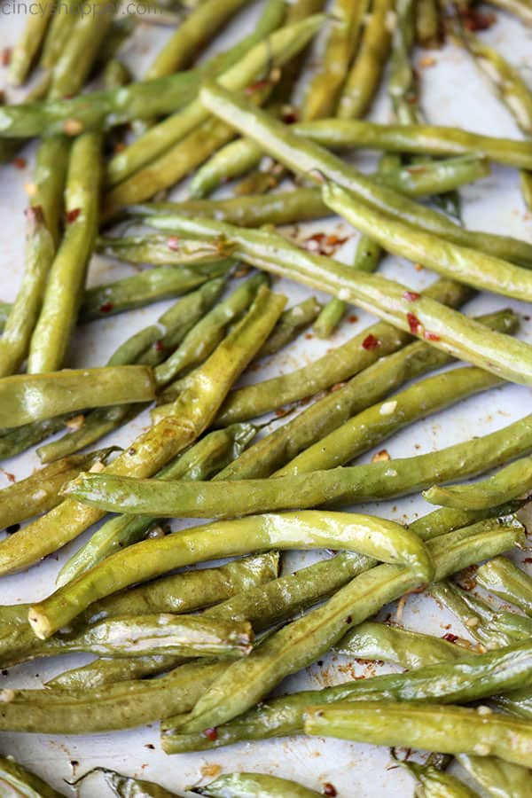 Roasted green beans on a sheet pan.