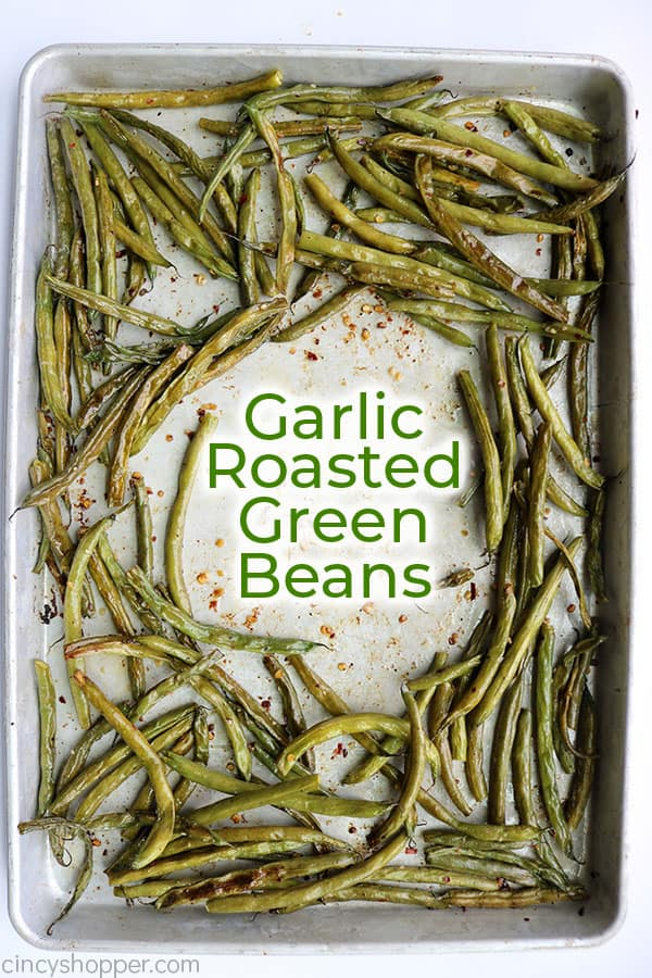 Roasted green beans on a sheet pan with text.