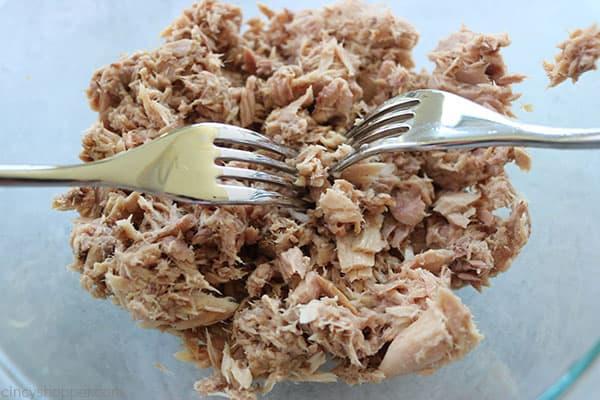 Shredding tuna for pasta salad.