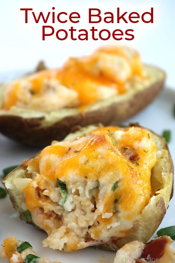 Twice Baked Potatoes on a plate with text.