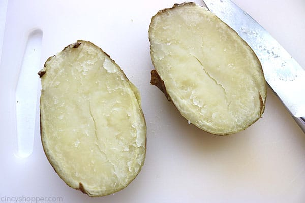 Potatoes cut in half to make easy twice baked potatoes.