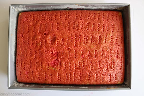 Chilled poke cake in a pan.