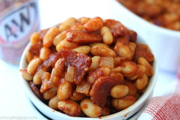 Root beer baked beans in a white bowl.