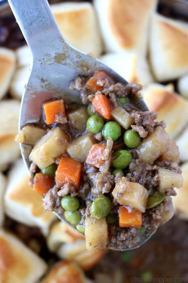Spoon of ground beef skillet dinner.