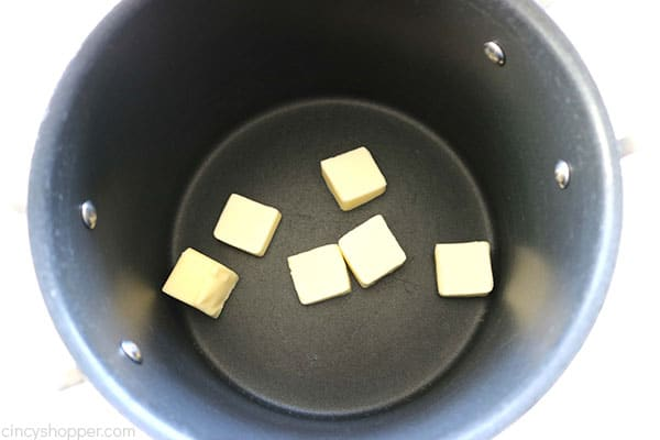 Melting the butter for Rice Krispie Treats.