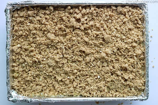 Streusel topping on apple cheesecake bars.