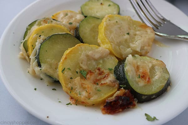 Creamy Parmesan Zucchini slices on plate.