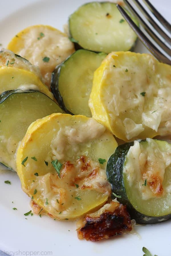 Parmesan Zucchini Casserole on a white plate.