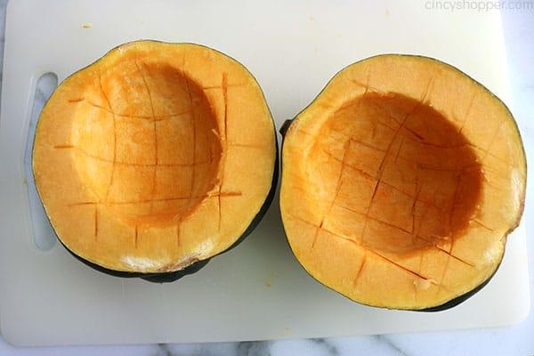 Scored acorn squash halves.