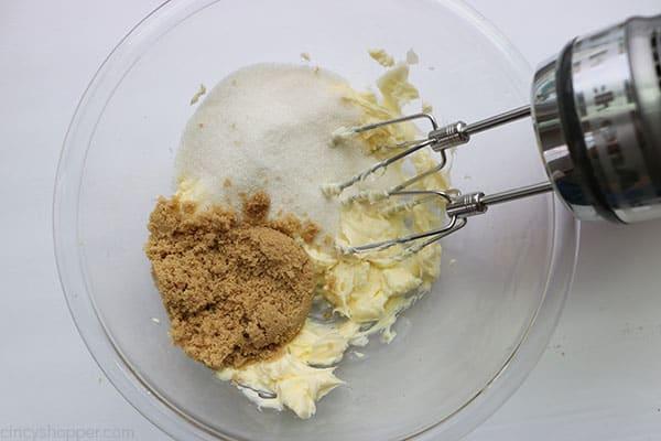 Pumpkin cookie dough being mixed.