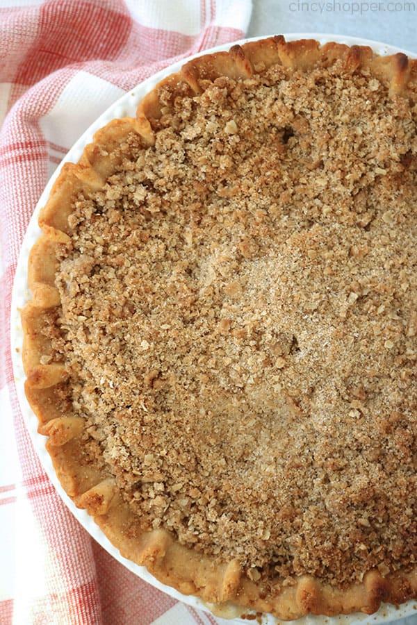 Dutch Apple Pie in a white deep dish pie plate.