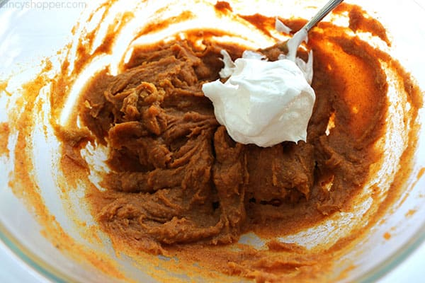Adding Cool-Whip to pumpkin mixture for Pumpkin Dip.