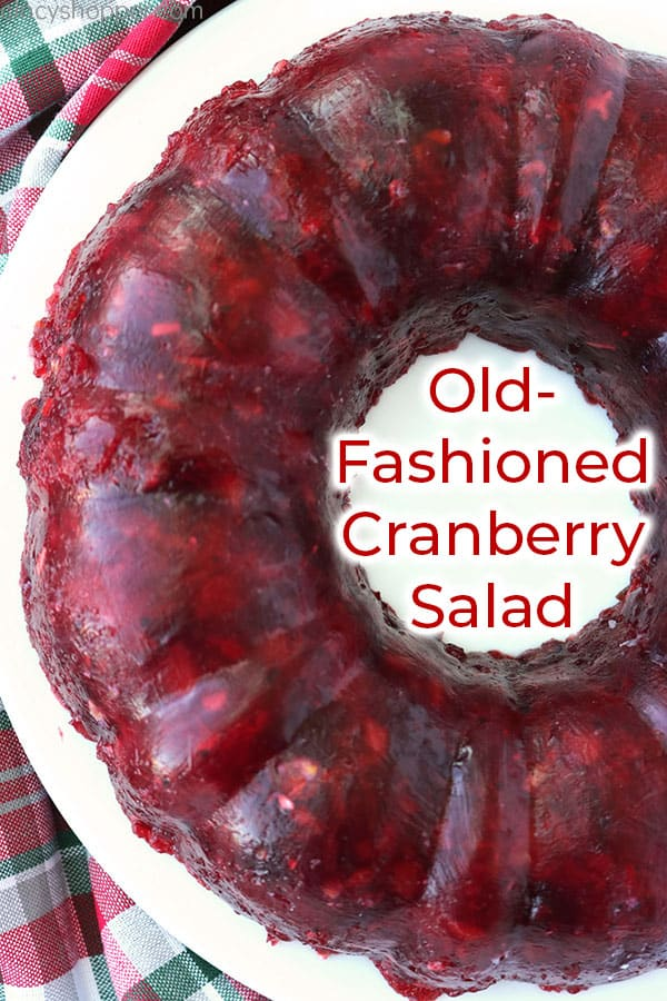 Cranberry Jello Mold on a white plate.