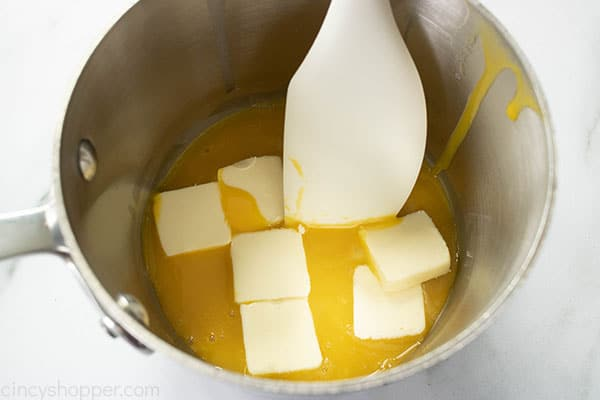 pads of butter added to the egg yolks