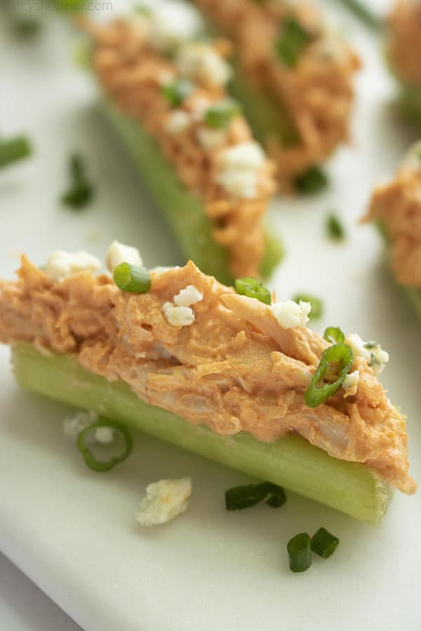 platter of celery sticks with Buffalo chicken topping