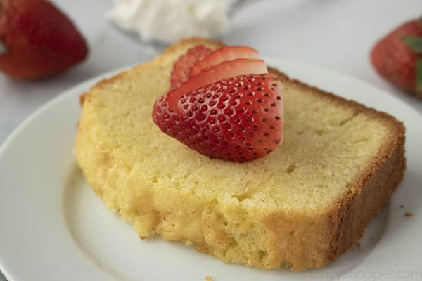 slice of easy pound cake on a plate with strawberries