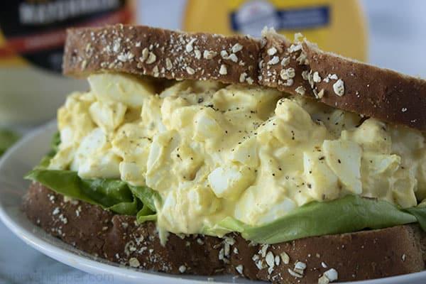 egg salad sandwich on wheat bread with lettuce