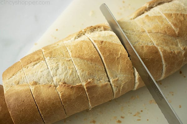 cutting French bread into slices