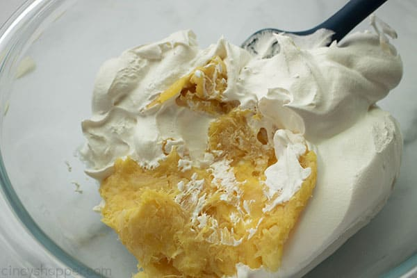 Folding crushed pineapple and Cool-Whip