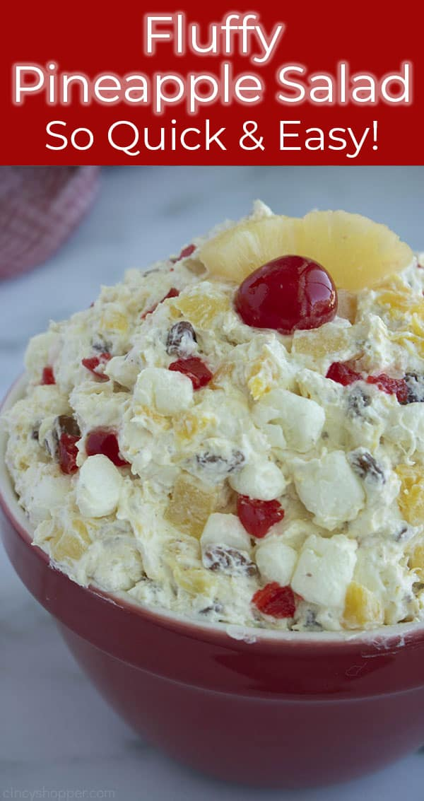 Pineapple Salad in a red bowl with cherry on top