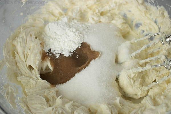 adding sugar, cornstarch, and vanilla to cream cheese mixture