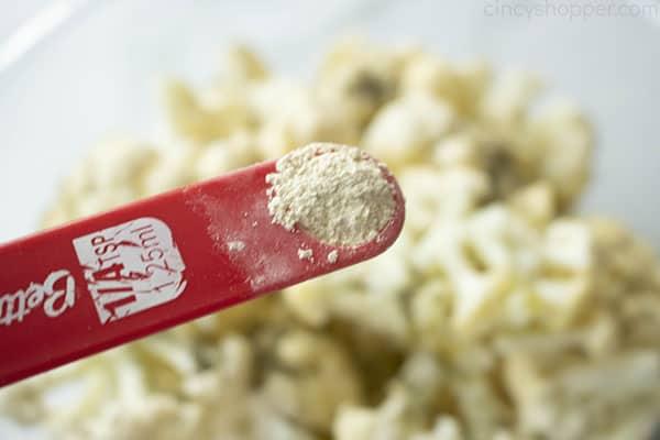 How to make Roasted Cauliflower, step 3: Add the garlic powder to the cauliflower.