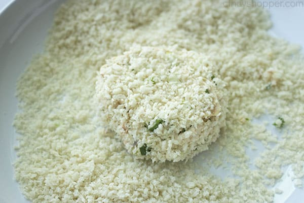 coating salmon patty in bread crumb mixture
