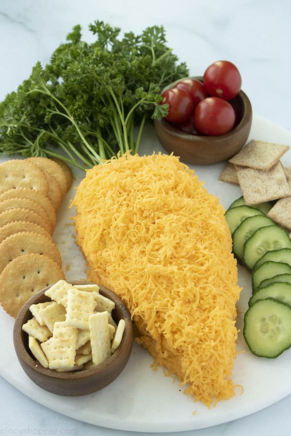 Carrot Shaped Cheese ball on tray with veggies and crackers