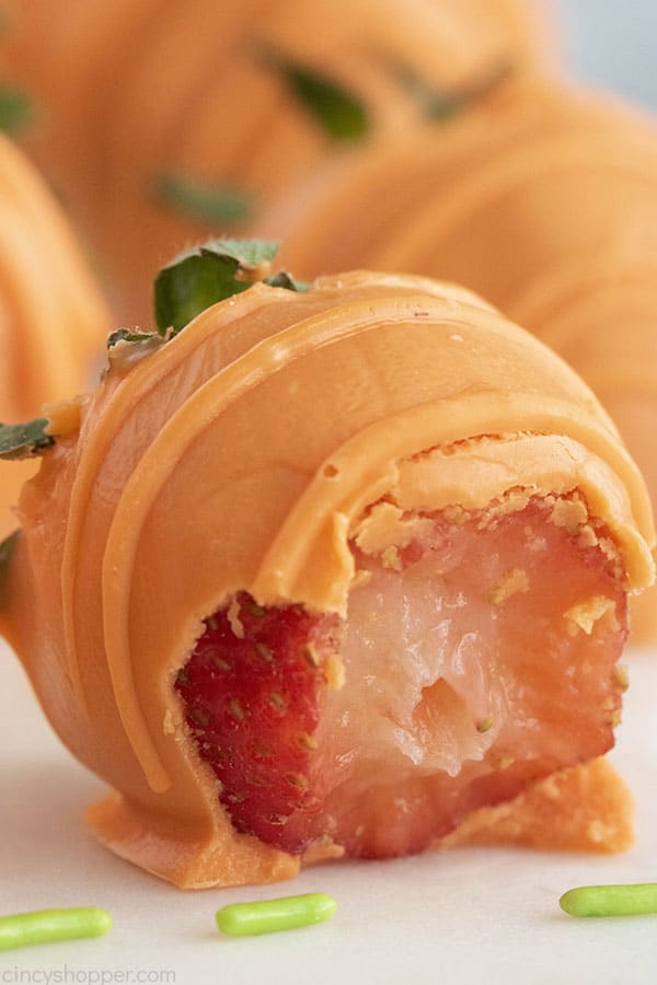 Orange Chocolate Dipped Strawberries with bite.