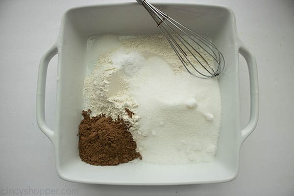 whisking flour, cocoa powder, salt, and sugar in a square baking dish