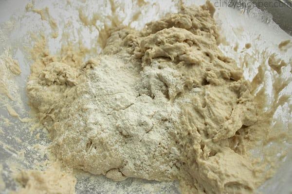 making a bread recipe - incorporating flour into shaggy dough