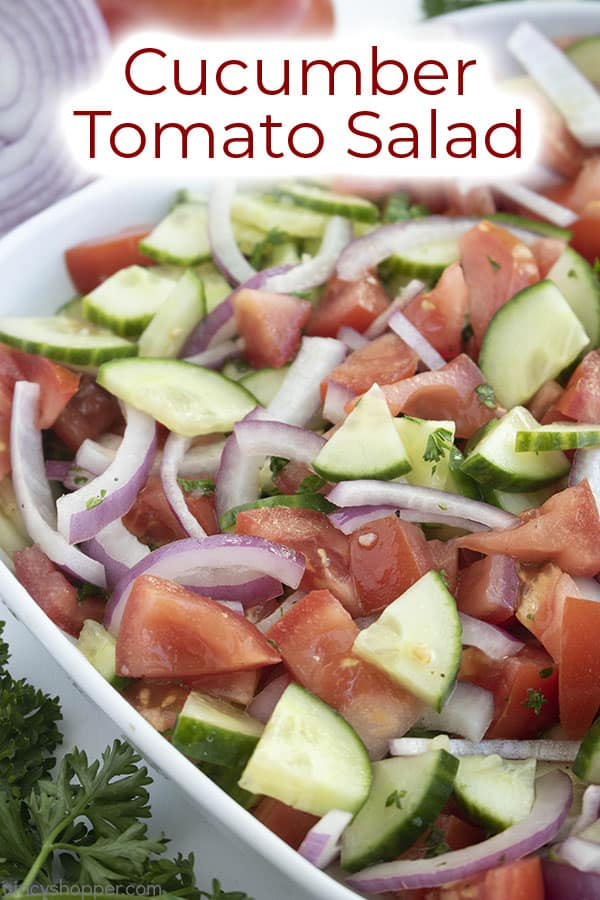 bowl of cucumber tomato salad with heading at the top