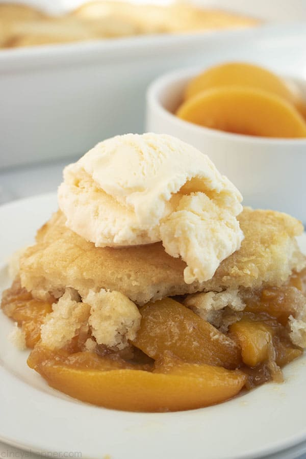 Peach Cobbler with Canned Peaches on a plate with scoop of ice cream
