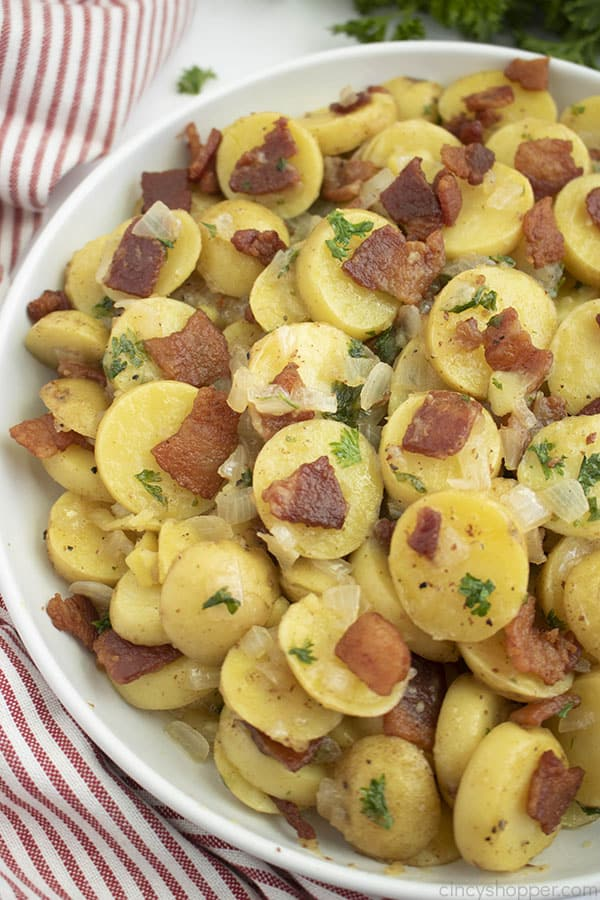 Bowl of warm potato salad with bacon