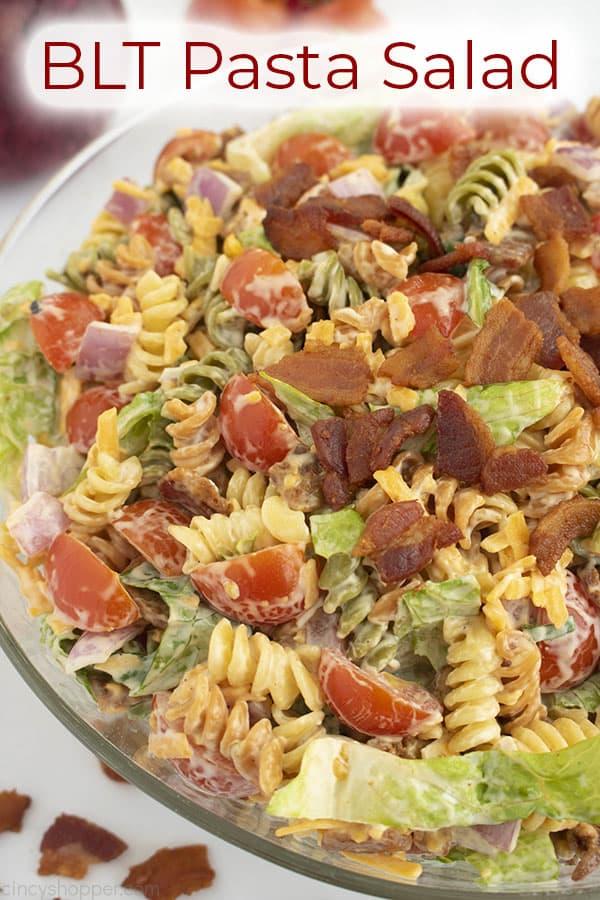 Bowl of cold pasta salad titled BLT Pasta Salad